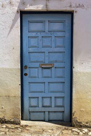 Blue door with mailbox Фото со стока