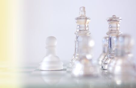One pawn staying against full set of chess pieces Stok Fotoğraf - 131222030
