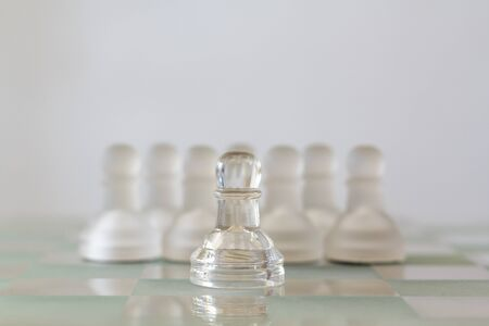 One pawn staying against set of chess pieces Stok Fotoğraf - 131221941