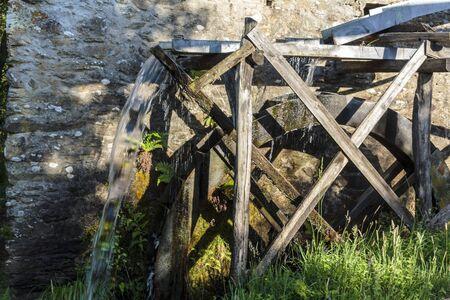 Working watermill wheel Stock Photo