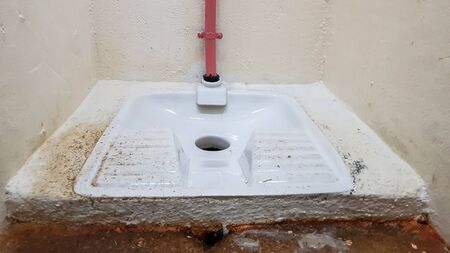 Squat toilet in a public restroom Stock Photo