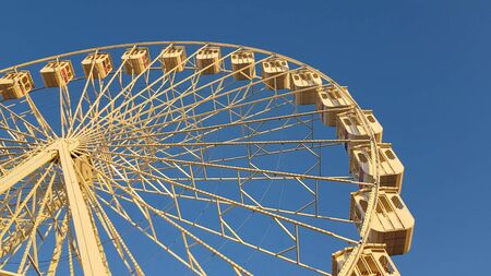 Ferris wheel against blue sky