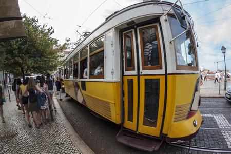 Vintage yellow tram in Lisbon, Portugal