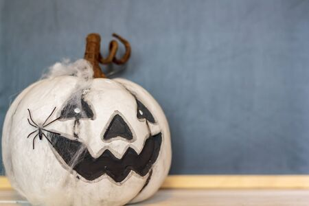 Halloween pumpkin with blackboard on the background and copy space Фото со стока