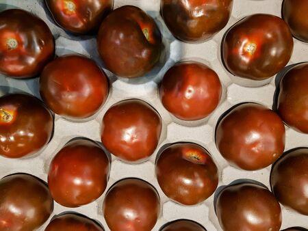 Top view of Kumato tomatoes Stok Fotoğraf