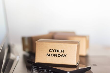 Carton box, smartphone and computer. Online shopping, e-commerce, Cyber Monday concept