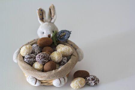 Bunny basket with chocolate almond eggs inside