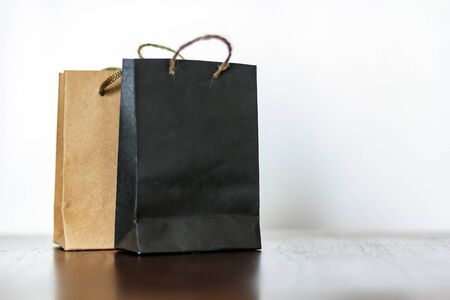 Shopping bags on wooden table