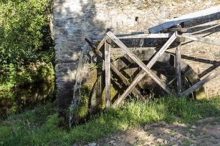 Working watermill wheel Standard-Bild