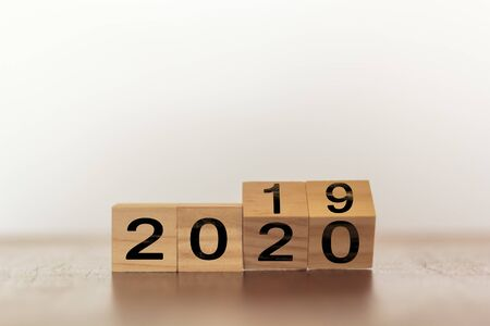 New year 2019 change to 2020. Wooden cubes with copy space Stok Fotoğraf