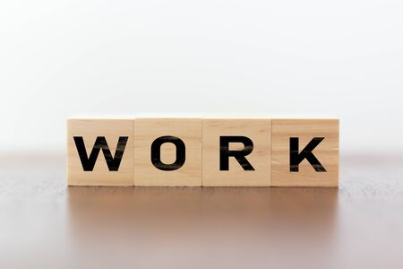Work word written on wooden cubes Foto de archivo