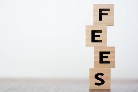 Fees word written on wooden cubes with copy space