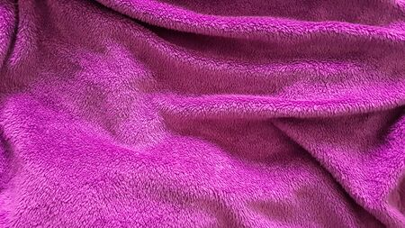 Top view of pink blanket with wrinkles