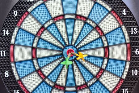 Dartboard with arrows on the center. Business and successful strategy concept