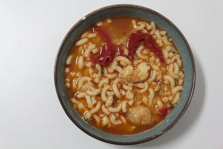 Bowl with Fish pasta soup. A Portuguese typical dish called massada de peixe
