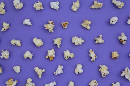 Set of popcorn on purple background