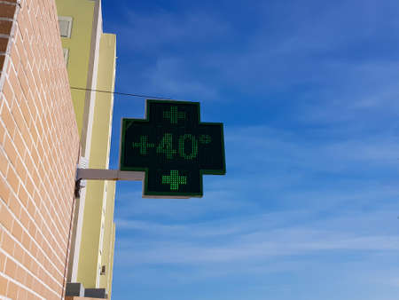 Pharmacy sign marks more than 40 degrees Celsius at hot day