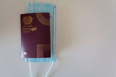 Top view of portuguese passport and medical mask on white table with copy space Reklamní fotografie