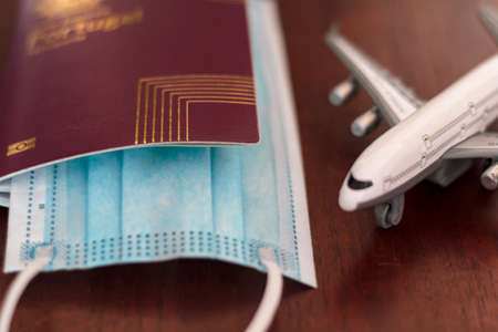 Passport with protective mask and airplane. Concept of Traveling during coronavirus, covid-19 pandemic Reklamní fotografie