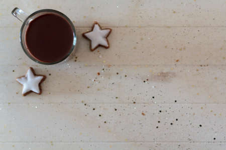 Top view of hot chocolate and star-shaped cookies. With copy space 写真素材