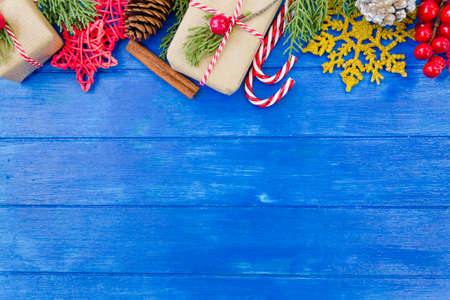 Christmas decoration top border on blue wooden table with copy space. Christmas background