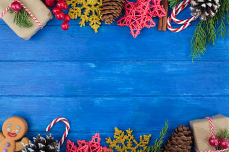 Christmas decoration double border on blue wooden table with copy space. Christmas background