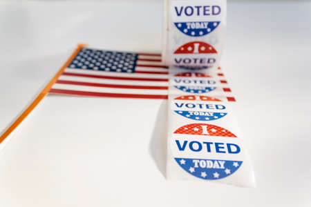 I Voted Today stickers and american flag on white background. US presidential election concept