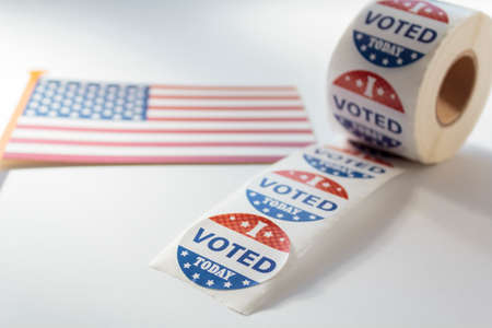 I Voted Today stickers and USA flag on white background. US presidential election concept Stock Photo