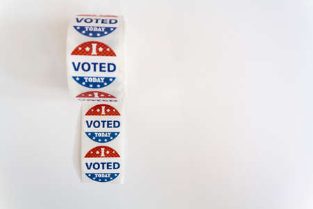 Roll of I Voted Today stickers on white background. Top view with copy space. US presidential election concept
