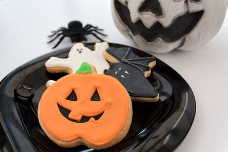 Halloween biscuits on white background