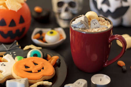 Halloween table with spooky treats and scary decoration