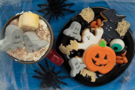 Top view of Halloween snack with spooky drink, cookies and treats Zdjęcie Seryjne