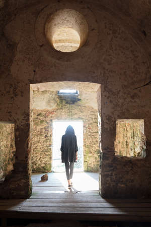 Rear view of woman in abandoned chapel