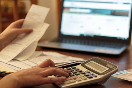 Woman doing financial accounting. Savings, finances and economy concept