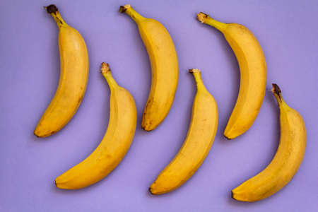 Top view of Bananas on purple background
