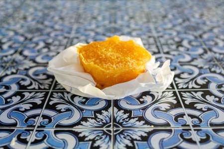 Traditional portuguese sweet bean tart called Pastel de Feijao on portuguese tiles background Reklamní fotografie