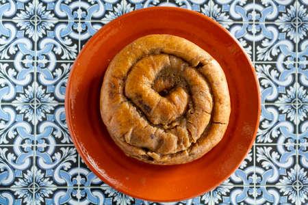 Top view of portuguese easter cake called Folar Algarvio de Olhao on portuguese tiles background Reklamní fotografie