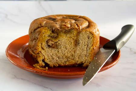 Portuguese easter cake called Folar Algarvio de Olhao with knife