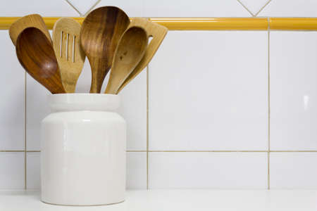Wooden spoons on kitchen with copy space