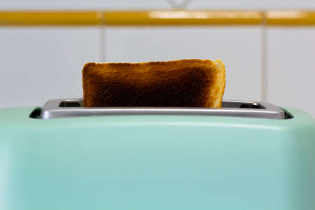 Burnt toast jumping out of the toaster Reklamní fotografie