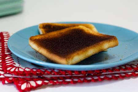 Burnt toast bread on plate