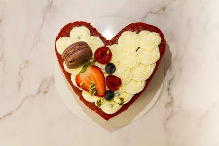 Top view of heart shaped red velvet cake