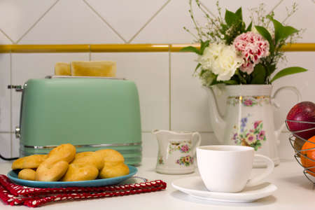Breakfast table with toasted bread, cookies, coffee and fresh flowers Reklamní fotografie