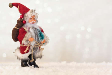 Santa Claus on snow with shiny background with copy space