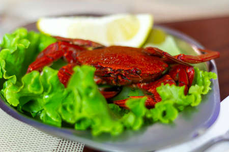 Plate with red crab ready to eat