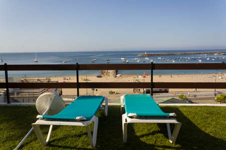 Sun lounges with sea on the background
