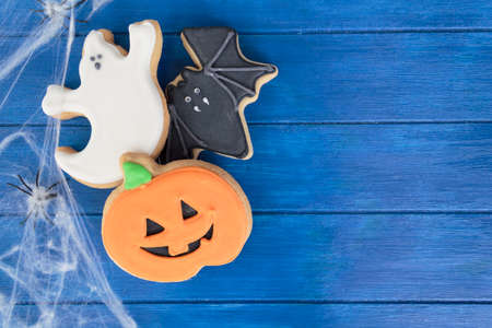 Halloween cookies on decorated table. Top view with copy space