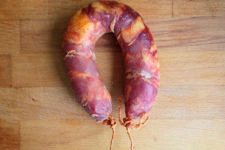 Traditional Portuguese sausage Chorizo on wooden board