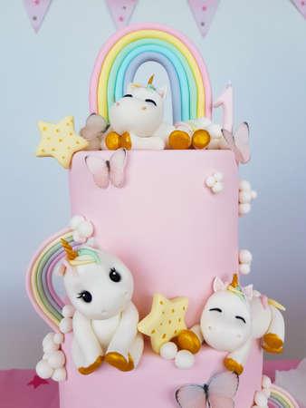 Birthday cake with unicorns and rainbow