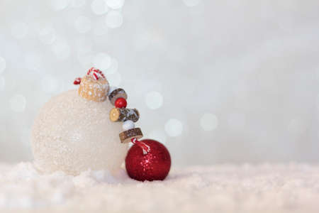 Christmas balls on snowy background with copy space